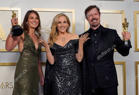 Marlee Matlin (C) poses with Pippa Ehrlich (L) and James Reed (R), winners of the award for best documentary feature for 'My Octopus Teacher,' in the press room at the 93rd annual Academy Awards ceremony at Union Station in Los Angeles, California, USA, 25 April 2021. The Oscars are presented for outstanding individual or collective efforts in filmmaking in 24 categories. The Oscars happen two months later than originally planned, due to the impact of the coronavirus COVID-19 pandemic on cinema.