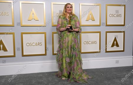 Emerald Fennell, winner of the award for best original screenplay for 'Promising Young Woman,' poses in the press room at the 93rd annual Academy Awards ceremony at Union Station in Los Angeles, California, USA, 25 April 2021. The Oscars are presented for outstanding individual or collective efforts in filmmaking in 24 categories. The Oscars happen two months later than originally planned, due to the impact of the coronavirus COVID-19 pandemic on cinema.