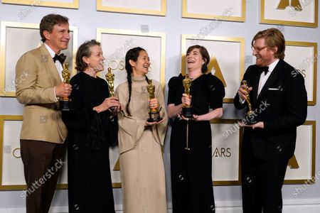 Peter Spears, Frances McDormand, Chloe Zhao, Mollye Asher and Dan Janvey, winners of the award for best picture for 'Nomadland,' pose in the press room at the 93rd annual Academy Awards ceremony at Union Station in Los Angeles, California, USA, 25 April 2021. The Oscars are presented for outstanding individual or collective efforts in filmmaking in 24 categories. The Oscars happen two months later than originally planned, due to the impact of the coronavirus COVID-19 pandemic on cinema.