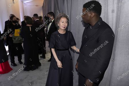 Youn Yuh-jung (L), winner of the award for best actress in a supporting role for 'Minari,' and Daniel Kaluuya (R), winner of the award for best actor in a supporting role for 'Judas and the Black Messiah,' talk outside the press room at the 93rd annual Academy Awards ceremony at Union Station in Los Angeles, California, USA, 25 April 2021. The Oscars are presented for outstanding individual or collective efforts in filmmaking in 24 categories. The Oscars happen two months later than originally planned, due to the impact of the coronavirus COVID-19 pandemic on cinema.