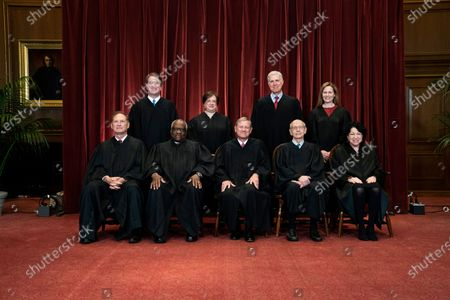 Members of the Supreme Court pose for a group photo at the Supreme Court in Washington. Seated from left are Associate Justice Samuel Alito, Associate Justice Clarence Thomas, Chief Justice John Roberts, Associate Justice Stephen Breyer and Associate Justice Sonia Sotomayor, Standing from left are Associate Justice Brett Kavanaugh, Associate Justice Elena Kagan, Associate Justice Neil Gorsuch and Associate Justice Amy Coney Barrett. Before the Supreme Court this is week is an argument over whether public schools can discipline students over something they say off-campus