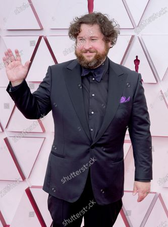 Michael Govier arrives for the 93rd annual Academy Awards ceremony at Union Station in Los Angeles, California, USA, 25 April 2021. The Oscars are presented for outstanding individual or collective efforts in filmmaking in 24 categories. The Oscars happen two months later than originally planned, due to the impact of the coronavirus COVID-19 pandemic on cinema.