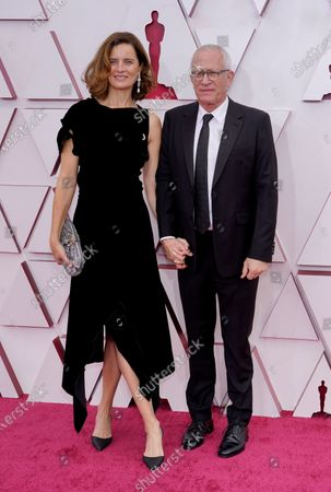Sophie Newton (L) and James Newton Howard arrive for the 93rd annual Academy Awards ceremony at Union Station in Los Angeles, California, USA, 25 April 2021. The Oscars are presented for outstanding individual or collective efforts in filmmaking in 24 categories. The Oscars happen two months later than originally planned, due to the impact of the coronavirus COVID-19 pandemic on cinema.