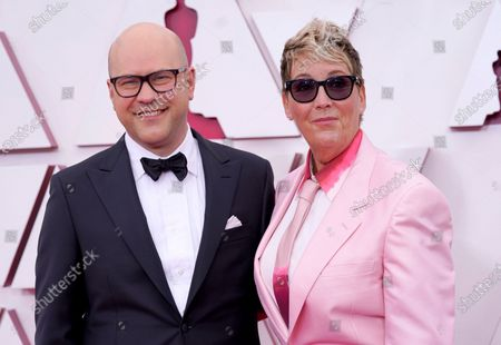 Stock Photo of Dan Scanlon (L) and Kori Rae arrive for the 93rd annual Academy Awards ceremony at Union Station in Los Angeles, California, USA, 25 April 2021. The Oscars are presented for outstanding individual or collective efforts in filmmaking in 24 categories. The Oscars happen two months later than originally planned, due to the impact of the coronavirus COVID-19 pandemic on cinema.