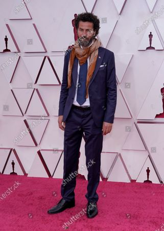 Stock Image of Saleh Bakri arrives for the 93rd annual Academy Awards ceremony at Union Station in Los Angeles, California, USA, 25 April 2021. The Oscars are presented for outstanding individual or collective efforts in filmmaking in 24 categories. The Oscars happen two months later than originally planned, due to the impact of the coronavirus COVID-19 pandemic on cinema.