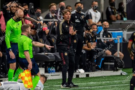 Atlanta United head coach Gabriel Heinze reacts during an MLS soccer match against the Chicago Fire, in Atlanta. Atlanta United won 3-1