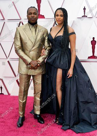 Leslie Odom Jr., left, and Nicolette Robinson arrive at the Oscars
