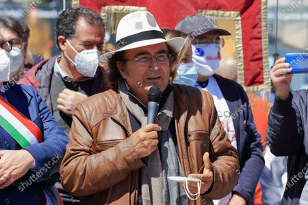 """Naples, Italy - April 25,2021 :many mayors of Southern Italy gathered in Piazza del Plebiscito to claim a fair distribution of the funds of the Recovery Found. Instead, the organizers of the event argue that the distribution would penalize the South in favour of the northern regions, thus disregarding the criteria indicated by Brussels based on GDP, population and unemployment"""".The Mayor of Naples, Luigi De Magistris, welcomed about eighty mayors from various cities in Southern Italy. Guest of exception the famous singer of Apulian origin but of international fame Al Bano Carrisi.Present in addition to the nostalgic of the Kingdom of the Two Sicilies and movements for the Independence of the South, also associations for the fight against the demolition of houses in the territory of Campania.International singer Al Bano Carrisi"""