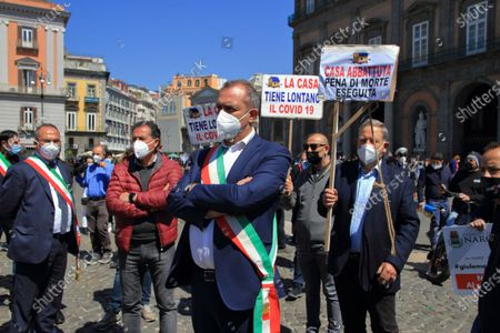 """Naples, Italy - April 25,2021 :many mayors of Southern Italy gathered in Piazza del Plebiscito to claim a fair distribution of the funds of the Recovery Found. Instead, the organizers of the event argue that the distribution would penalize the South in favour of the northern regions, thus disregarding the criteria indicated by Brussels based on GDP, population and unemployment"""".The Mayor of Naples, Luigi De Magistris, welcomed about eighty mayors from various cities in Southern Italy. Guest of exception the famous singer of Apulian origin but of international fame Al Bano Carrisi.Present in addition to the nostalgic of the Kingdom of the Two Sicilies and movements for the Independence of the South, also associations for the fight against the demolition of houses in the territory of Campania."""