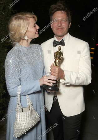 Stock Image of Director Thomas Vinterberg (right) and wife/actress Helene Reingaard Neumann attend the Another Round 93rd Annual Academy Awards Celebration on Sunday, Apr 25 in Los Angeles.