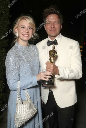 Stock Photo of Director Thomas Vinterberg (right) and wife/actress Helene Reingaard Neumann attend the Another Round 93rd Annual Academy Awards Celebration on Sunday, Apr 25 in Los Angeles.