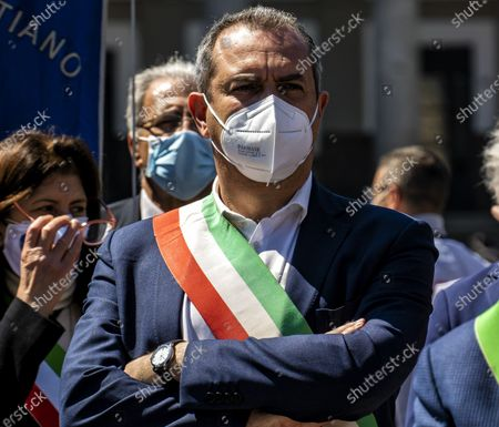 """NAPLES, ITALY - APRIL 25: The mayor of Naples Luigi De Magistris. The Mayors of the South in Naples, we are not a ballast '. Tricolor band on the chest and an exceptional testimonial as a companion in the fight, Al Bano Carrisi, the mayors of the South gathered in Naples to claim an equitable distribution of the Recovery Plan funds. About eighty the first citizens from all the southern regions who met in Piazza del Plebiscito responding to the appeal of the Recovery Sud network, the movement started from the bottom, and fed by word of mouth, which gathers over 500 mayors of large and small municipalities . To welcome them the mayor of Naples, Luigi de Magistris, who explained the reasons for the protest: """"The Mezzogiorno would be entitled to 60% of the resources - he stressed - while we are at 40%, it is 60 billion less. The country wants to remain united must see in the South not a ballast but a great opportunity for redemption """"."""
