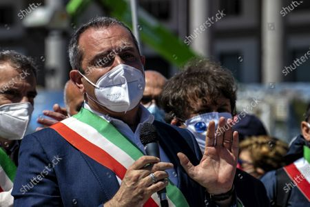 """NAPLES, ITALY - APRIL 25: The mayor of Naples Luigi De Magistris, during the intervention.The Mayors of the South in Naples, we are not a ballast '. Tricolor band on the chest and an exceptional testimonial as a companion in the fight, Al Bano Carrisi, the mayors of the South gathered in Naples to claim an equitable distribution of the Recovery Plan funds. About eighty the first citizens from all the southern regions who met in Piazza del Plebiscito responding to the appeal of the Recovery Sud network, the movement started from the bottom, and fed by word of mouth, which gathers over 500 mayors of large and small municipalities . To welcome them the mayor of Naples, Luigi de Magistris, who explained the reasons for the protest: """"The Mezzogiorno would be entitled to 60% of the resources - he stressed - while we are at 40%, it is 60 billion less. The country wants to remain united must see in the South not a ballast but a great opportunity for redemption """"."""