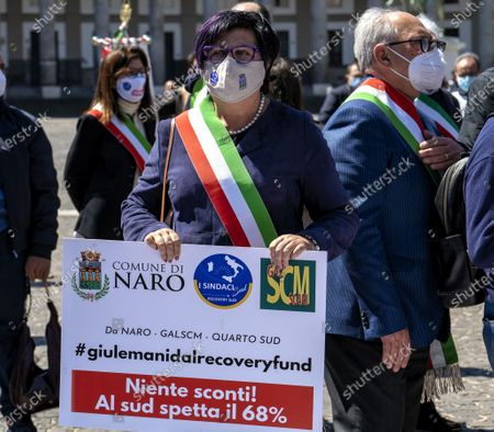 """NAPLES, ITALY - APRIL 25: The Mayors of the South in Naples, we are not a ballast '. Tricolor band on the chest and an exceptional testimonial as a companion in the fight, Al Bano Carrisi, the mayors of the South gathered in Naples to claim an equitable distribution of the Recovery Plan funds. About eighty the first citizens from all the southern regions who met in Piazza del Plebiscito responding to the appeal of the Recovery Sud network, the movement started from the bottom, and fed by word of mouth, which gathers over 500 mayors of large and small municipalities . To welcome them the mayor of Naples, Luigi de Magistris, who explained the reasons for the protest: """"The Mezzogiorno would be entitled to 60% of the resources - he stressed - while we are at 40%, it is 60 billion less. The country wants to remain united must see in the South not a ballast but a great opportunity for redemption """"."""