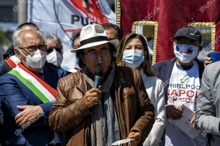 """NAPLES, ITALY - APRIL 25: Albano Carrisi during his speech in the square. The Mayors of the South in Naples, we are not a ballast '. Tricolor band on the chest and an exceptional testimonial as a companion in the fight, Al Bano Carrisi, the mayors of the South gathered in Naples to claim an equitable distribution of the Recovery Plan funds. About eighty the first citizens from all the southern regions who met in Piazza del Plebiscito responding to the appeal of the Recovery Sud network, the movement started from the bottom, and fed by word of mouth, which gathers over 500 mayors of large and small municipalities . To welcome them the mayor of Naples, Luigi de Magistris, who explained the reasons for the protest: """"The Mezzogiorno would be entitled to 60% of the resources - he stressed - while we are at 40%, it is 60 billion less. The country wants to remain united must see in the South not a ballast but a great opportunity for redemption """"."""