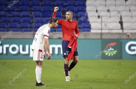 Stock Photo of Burak Yilmaz of Lille celebrates his winning goal while Mattia De Sciglio of Lyon looks down