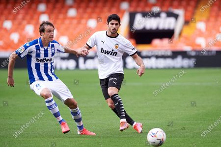 Goncalo Guedes of Valencia CF and Tomas Pina of Alaves