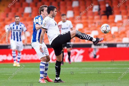 Maxi Gomez of Valencia CF and Tomas Pina of Alaves