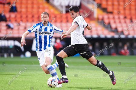 Maxi Gomez of Valencia CF and Florian Lejeune of Alaves