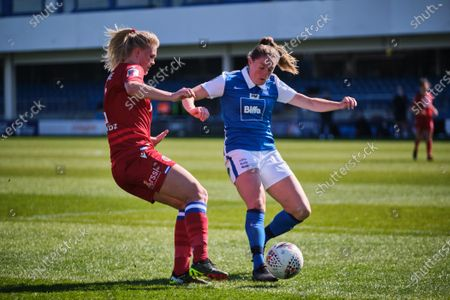 Kristine Leine (2 Reading) and Harriet Scott (3 Birmingham City) battle for the ball