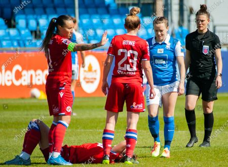 Harriet Scott (Birmingham City #3) bemused by injury as Rachel Rowe (#23 Reading)- looks on