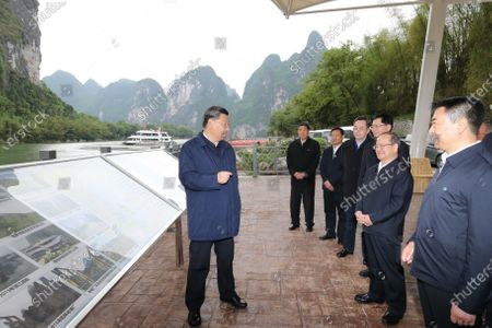 (210425) - GUILIN, April 25, 2021 (Xinhua) - Chinese President Xi Jinping, also general secretary of the Communist Party of China Central Committee and chairman of the Central Military Commission, visits a section of the Lijiang River and learns about local efforts in the ecological conservation of the river in Yangshuo, south China's Guns angxi Zhuang Autonomous Region, April 25, 2021. Xi Jinping on Sunday inspected Guangxi Zhuang Autonomous Region.