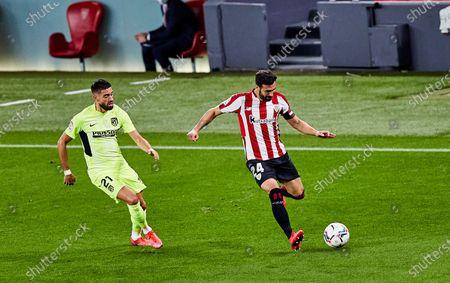 Yannick Carrasco of Atletico de Madrid and Mikel Balenciaga of Athletic Club