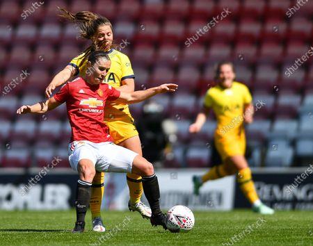 Jane Goldman (19 Manchester United) battles for the ball with Kit Graham (16 Tottenham)