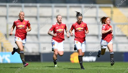 Jane Goldman (19 Manchester United), Maria Thorisdottir (3 Manchester United), Leah Galton (11 Manchester United) and Martha Harris (2 Manchester United) warm down after the Womens Super League game between Manchester United and Tottenham Hotspur at Leigh Sports Village in Leigh, England.