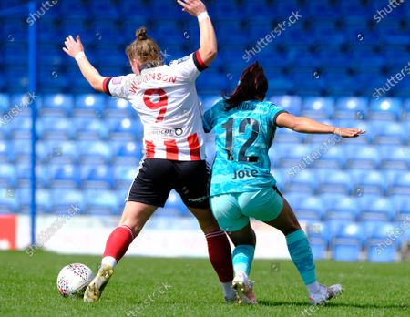 Katie Wilkinson ( 9 Sheffield ) Taylor Hinds ( 12 Liverpool ) battling for the ball