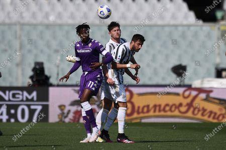 Christian Kouamè of ACF Fiorentina in action against Rodrigo Bentancur of Juventus FC