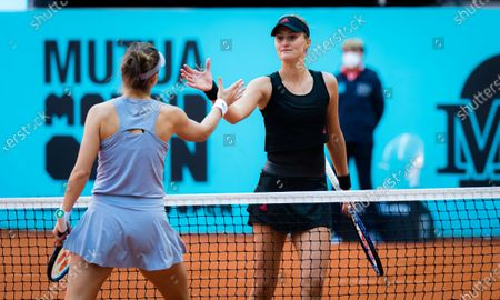 Belinda Bencic of Switzerland & Kristina Mladenovic of France at the net after their first-round match of the 2021 Mutua Madrid Open WTA 1000 tournament