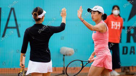 Stock Photo of Yifan Xu & Shuai Zhang of China playing doubles at the 2021 Mutua Madrid Open WTA 1000 tournament