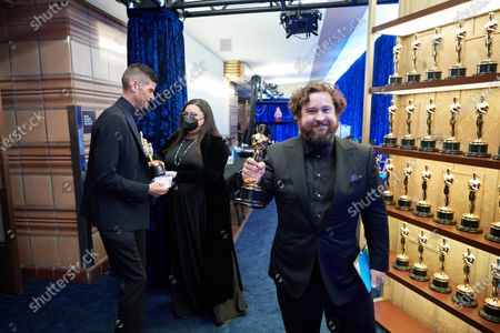 Stock Picture of Michael Govier (R) and Will McCormack backstage with the Oscar® for Animated Short Film during the live ABC Telecast of The 93rd Oscars® at Union Station in Los Angeles, CA on Sunday, April 25, 2021.