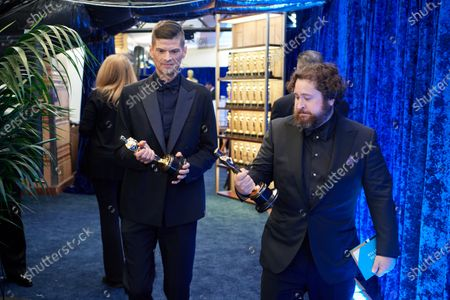 Stock Image of Michael Govier (R) and Will McCormack pose backstage with the Oscar® for Animated Short Film during the live ABC Telecast of The 93rd Oscars® at Union Station in Los Angeles, CA on Sunday, April 25, 2021.