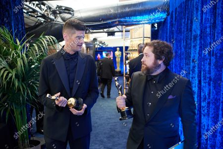 Michael Govier (R) and Will McCormack pose backstage with the Oscar® for Animated Short Film during the live ABC Telecast of The 93rd Oscars® at Union Station in Los Angeles, CA on Sunday, April 25, 2021.