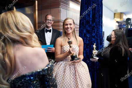 Stock Image of Pete Docter and Dana Murray head backstage with the Oscar® for Animated Feature Film during the live ABC Telecast of The 93rd Oscars® at Union Station in Los Angeles, CA on Sunday, April 25, 2021.