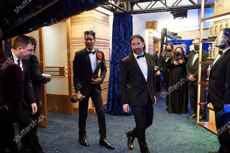 Jon Batiste and Trent Reznor backstage with the Oscar® for Original Score during the live ABC Telecast of The 93rd Oscars® at Union Station in Los Angeles, CA on Sunday, April 25, 2021.
