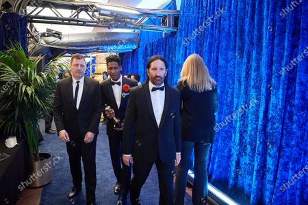 Atticus Ross, Jon Batiste and Trent Reznor backstage with the Oscar® for Original Score during the live ABC Telecast of The 93rd Oscars® at Union Station in Los Angeles, CA on Sunday, April 25, 2021.