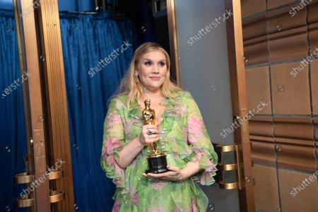 Stock Picture of Emerald Fennell accepts the Oscar® for Original Screenplay during the live ABC Telecast of The 93rd Oscars® at Union Station in Los Angeles, CA on Sunday, April 25, 2021.