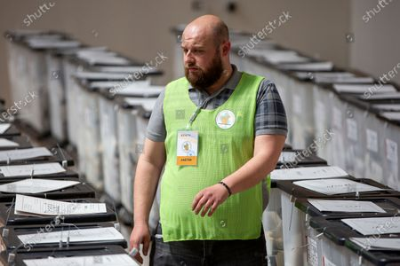 Election official walks among ballot boxes at the counting center in capital Tirana, Albania on . Preliminary results on Monday show the ruling Socialist Party ahead in Albania's parliamentary election. With one-third of the votes counted the left-wing Socialists of Prime Minister Edi Rama have won 50% of the votes, followed by the main opposition center-right Democratic Party of Lulzim Basha with 39