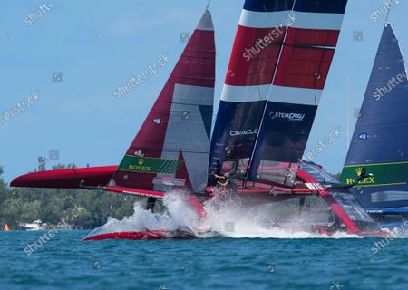 Great Britain SailGP Team presented by INEOS helmed by Sir Ben Ainslie in close action with USA SailGP Team during Bermuda SailGP presented by Hamilton Princess, Event 1 Season 2 in Hamilton, Bermuda. 23 April 2021.