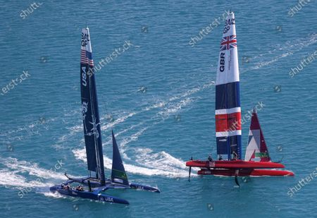 Great Britain SailGP Team presented by INEOS helmed by Sir Ben Ainslie ahead of USA SailGP Team helmed by Jimmy Spithill in action during Bermuda SailGP presented by Hamilton Princess, Event 1 Season 2 in Hamilton, Bermuda. 23 April 2021.