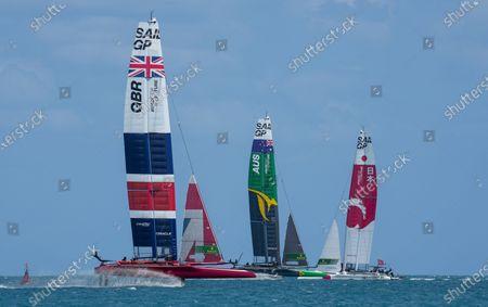 Great Britain SailGP Team presented by INEOS helmed by Sir Ben Ainslie, Australia SailGP Team helmed by Tom Slingsby and Japan SailGP Team helmed by Nathan Outterridge in action during Bermuda SailGP presented by Hamilton Princess, Event 1 Season 2 in Hamilton, Bermuda. 23 April 2021.