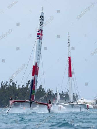Great Britain SailGP Team presented by INEOS helmed by Sir Ben Ainslie ahead of Japan SailGP Team helmed by Nathan Outterridge on Race Day 2. Bermuda SailGP presented by Hamilton Princess, Event 1 Season 2 in Hamilton, Bermuda. 25 April 2021.