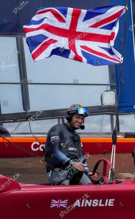 Sir Ben Ainslie clutches his champagne bottle and the Great Britain SailGP Team presented by INEOS remain on their F50 due to COVID-19 restrictions to celebrate their win in the final race on Race Day 2. Bermuda SailGP presented by Hamilton Princess, Event 1 Season 2 in Hamilton, Bermuda. 25 April 2021.