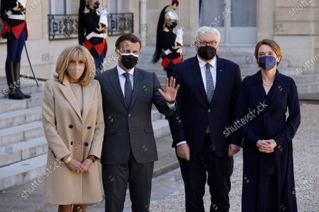 French President Emmanuel Macron (2-L) and French First Lady Brigitte Macron (L) greet German President Frank-Walter Steinmeier (2-R) and his wife Elke Buedenbender (R) upon their arrival at the Elysee Palace in Paris, France, 26 April 2021.
