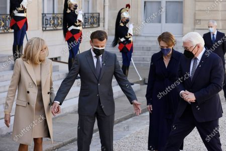 French President Emmanuel Macron (2-L) and French First Lady Brigitte Macron (L) greet German President Frank-Walter Steinmeier (R) and his wife Elke Buedenbender (2-R) upon their arrival at the Elysee Palace in Paris, France, 26 April 2021.