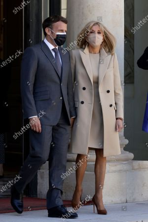 French President Emmanuel Macron (L) and French First Lady Brigitte Macron (R) walk out the Elysee Palace to welcome German President Frank-Walter Steinmeier and his wife Elke Buedenbender (unseen) upon their arrival in Paris, France, 26 April 2021.