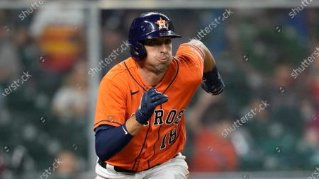 Houston Astros' Jason Castro runs down the first base line during the 10th inning of a baseball game against the Los Angeles Angels, in Houston
